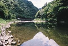 Mukogawa (Pitch Black | Damasus Ekodimus) Tags: nature water reflection rocks trail river nikonfe superiaxtra400 green film 35mmfilm analog