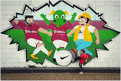 First to the ball! (Jason 87030) Tags: ntfc cobblers nortamptontownfc sixfields stadium mural wall art marcrichards clarence dragon mickgeorge nike clayton ball football soccer family fun day 2017 july uk paint kick pose son
