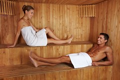 13713189_m (worldclassclubs) Tags: woman man sauna happy wellness relaxation spa talk chat flirting couple laughing recreation calm health lie heat sweat sweating leisure wood steambath beautiful body girl healthy hotel skin wellbeing beauty attractive friends luxury pleasure bath therapy towel therme relax holiday care steamsauna enjoy joyful healthresorttreatment comfortable people person caucasian