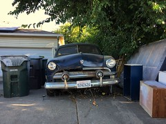 Trash Day (misterbigidea) Tags: projectcar sadwheels bulletbumper chrome landscape neighborhood garbage treasure crusty rusty decay relic parked driveway trash hotwheels auto vintage classic sedan victoria ford 1951 city suburban home forgotten