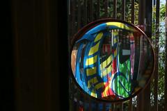 Fisheye multicolor (Pi-F) Tags: miroir multicolor rond rétroviseur glace funicullaire tag peinture tunnel grille barre noir obscurité lumière contraste barcelone espagne composition fisheye couleur abstrait extincteur rouge dessin