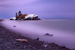 Cool Morning at Hollow Rock (John D. Stocker) Tags: johnstocker paintedspur photography wwwpaintedspurphotographycom hollowrock hollow rock grandportage lakesuperior greatlakes lake shore sea seascape longexposure neutral density purple winter mist waves ice icy snow rocks driftwood trees formation resort north mn minnesota coast beach landscape water