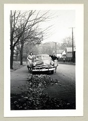 """1949 Ford (Vintage Cars & People) Tags: vintage us usa america vintageusa classic black white """"blackwhite"""" sw photo foto photography automobile car cars motor vehicle antique auto 1940s forties ford 1949ford fordor fordsedan lady ladies dress skirt street autumn trees leaves residentialstreet suburbia shoebox"""