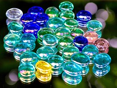 Glass beads (rustyruth1959) Tags: ssc nikon nikond3200 sigma105macro saturdayselfchallenge beads glass mirror glassbeads colouredglass outdoors macro bokeh closeup worn tree reflections blue clear