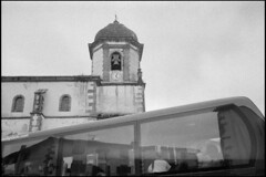 Tourists in Zugarramurdi (Romain Massola) Tags: paysbasque paisvasco euskalherria euskadi eglise church touriste tourist bus car zugarramurdi leica m6 canon 50mm canon50mmf14ltm ilford hp5 bw nb blackandwhite noiretblanc bwfp epson v700 epsonv700 rodinal