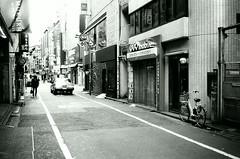 Sunday morning (Shoji Kawabata. a.k.a. strange_ojisan) Tags: fuji film klasse s lomography earygray 100 35mm filmphoto filmphotography lomo black white bnw mono monochrome shibuya tokyo japan street streetphoto streetphotography city cityscape cityscapes earlymorning morning holiday sundaymorning sunday