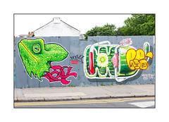 Street Art (Frankie Strand, HNRX), East London, England. (Joseph O'Malley64) Tags: frankiestrand hnrx streetartists streetart urbanart publicart freeart graffiti eastlondon eastend london england uk britain british greatbritain art artist artistry artwork artists mural fencing corrugatedsteelfencepanels victorianbuilding victorianstructure brickwork bricksmortar cement pointing londonplanetrees pavement concrete granitekerbing tarmac doubleyellowlines noparkingatanytime parkingrestrictions speedhump trafficcalming urban urbanlandscape aerosol cans spray paint fujix x100t accuracyprecision