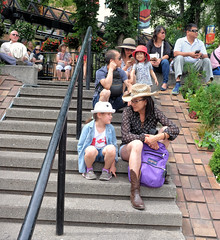 Calgary Stampede, Downtown Action (Sherlock77 (James)) Tags: calgary downtown stephenavenue streetphotography people stairs woman child cowboyhat