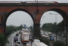 M60 Stockport Viaduct (J_Piks) Tags: rain road motorway m60 traffic cars lampposts streetlighting streetlights stockport train railway viaduct bridge