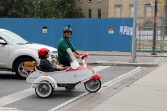 A couple, a dog, a scooter and a side-car (Can Pac Swire) Tags: toronto ontario canada canadian city centre center downtown 2017aimg1916 motorcycle sidecar scooter moped motorbike man woman couple dog goggles vespa