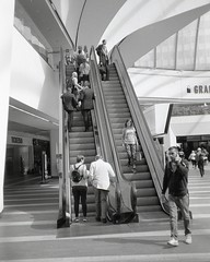 ups and downs (OhDark30) Tags: olympus 35rc 35 rc film 35mm monochrome bw blackandwhite bwfp fuji neopan acros 100 escalator stairs grandcentral shopping newst station concourse travellers shoppers street candid