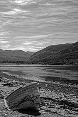 Wreck of Loch Linnhe. (alan.irons) Tags: onich a82 lochlinnhe lochleven ballachulishbridge westhighlands shoreline built1975 ferry tidalloch bw black white blackwhite mono canoneos1dxmkll scotland merge ecosse scottish argyll boat wreck beach