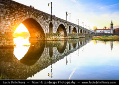 Portugal - North Region - Ponte de Lima & its medieval bridge during Sunset (© Lucie Debelkova / www.luciedebelkova.com) Tags: pontedelima northregion regiãonorte portugal portuguese mirandese portugueserepublic repúblicaportuguesa repúblicapertuesa portugalsko europe europeanunion southwesterneurope iberianpeninsula world exploration trip vacation holiday place destination location journey tour touring tourism tourist travel traveling visit visiting sight sightseeing wonderful fantastic awesome stunning beautiful breathtaking incredible lovely nice best perfect wwwluciedebelkovacom luciedebelkova