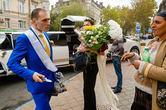 Odessa, Ukraine (f.d. walker) Tags: easterneurope europe odessa ukraine knife fight argument danger dangerous criminal flowers wedding suit colors color candidphotography candid clothes colorphotography city streetphotography street sunlight strange surreal soviet sovietunion