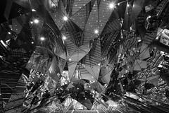 An escalator and some mirrors. (Chrislovesugly) Tags: loxia japan loxia21 sony mirrors tokyo harajuku