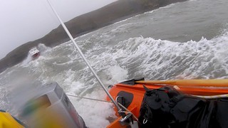 Porthcawl RNLI rescue fishing vessel aground at Southerndown beach