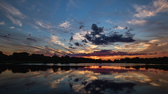 Tonights sunset.... (Kevin Povenz Thanks for the 3,300,000 views) Tags: 2017 july kevinpovenz westmichigan michigan ottawa ottawacounty maplewoodpark sunset evening dusk sky clouds blue yellow orange canon7dmarkii sigma1020 water reflection pond lake trees park longexposure