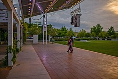 Crossing the Stage (brev99) Tags: d610 sigma2414 tulsa guthriegreen people stage cloudy sunset perfecteffects17 colorefex ononesoftware on1photoraw2017 cityscape