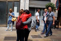 Barcelona (jaumescar) Tags: barcelona catalunya spain people streetphotography hug emotion friends couple emotive emocion abrazo red jacket farewell despedida walking street bag women boqueria market scene tourist
