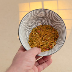 Nasi goreng spice mix. (annick vanderschelden) Tags: nasigoreng mix ingredients spices herb vegetables indonesia dried soak flavour preparation taste wok pork onion redpepper haricot salt aroma wheat barley coriander palmfat garlic sugar potatostarch curry mustardseed sunfloweroil hydrolizedvegetableproteins cumin maltodextrine pepper cayennepepper sesameoil soysauce shrimppowder beetextract lemonjuice yellow white pointofview hand humanhand bowl decorative lighteffect belgium