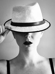 Tip of the Hat (nicolechamilton) Tags: portrait selfportrait blackwhite bw light monochrome nikon fedora hat lips clavicle timer shadows lightandshadow