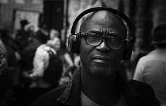 .... (dagomir.oniwenko1) Tags: men male man mono blackandwhite bw earphones canon candid portrait person portret people portraits ritratto retrato eyeglasses face
