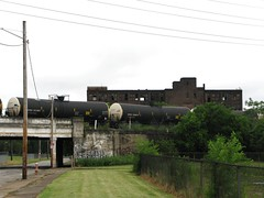 Former Glory (jhncurran) Tags: warehouse trains cleveland usa ohio blight tanks grey vacant inner deep chains growth green street