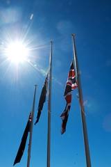 at half mast (Leonard J Matthews) Tags: flags three 3 halfmast tribute honour anzac anzacday redcliffe queensland australia memorial mythoto sun sky australian british newzealand pole