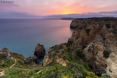 Ponta Da Piedade IV. (dasanes77) Tags: canoneos6d canonef1635mmf4lisusm tripod landscape seascape cloudscape waterscape clouds orange sunset sun yellow blue ocean sea algarve portugal lagos green cliffs calm nature longexposure pontadapiedade