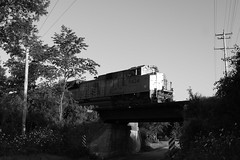 Beauty and the beast in B&W (MILW157) Tags: up union pacific norwegian road adams sub line train track railroad bridge