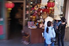 Bamboo Hats; China Town Street Scene (Richard Denney) Tags: chinatown victoria britishcolumbia streetscene colors vendors stores peopletalking bamboo hat conversation