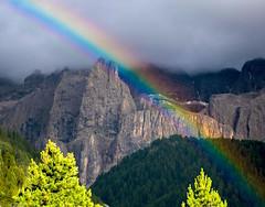 Mountains with Rainbow (bjorbrei) Tags: rainbow cliffs pines mountains sella selva wolkenstein valgardena gherdëina gröden dolomites dolomiten dolomiti tyrol tirol tirolo italy italia