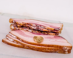 Delicious thick-sliced hickory smoked honey-Sriracha enrobed bacon.