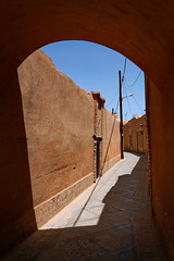 noon (freakingrabbit) Tags: city street blue light old architecture shadow arch desert archs iran yazd persia archeological adobe archway arco