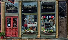 Sundrees (Gallery Gifts Boutique)-HWW! (☁☂It's Raining, It's Pouring☂☁) Tags: odc hiddengem shop gifts gallery boutique store small village trumansburg newyork fingerlakes upstateny street drivebyphoto hdr colourful doors windows items brown red black reflections signs