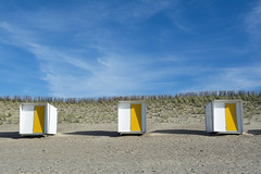 Three beach huts (Jan van der Wolf) Tags: map172161v beachhuts strand strandhuisjes geel yellow beach three drie herhaling landscape landschap seascape shore zand sand cadzand shadows schaduw schaduwen