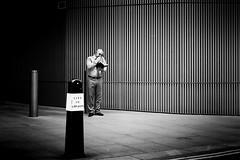 Dog And Bone (Sean Batten) Tags: london england unitedkingdom gb mobilephone milkstreet cityoflondon streetphotography street blackandwhite bw nikon df 50mm light shadow person people candid