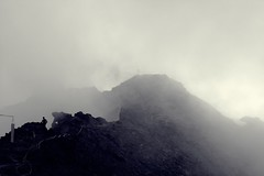 Out of thin air (No_Mosquito) Tags: monte vioz trentino alps europe mountain summit rocks clouds mist people hikers mountaineering monochrome bw thin air italy man cross canon powershot g7xmarkii pejo