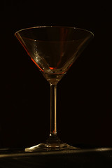 Waiting for Martini... (JPetrović) Tags: martini glass emptyglass martiniwitholive coctail summertime reflection dark background rayofllight canonphotography blackred