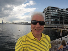On the Dock in Oslo (David J. Greer) Tags: oslo norway ocean sea dock person man male sunglasses grey hair astrup fearnley museum modern art daytime cloud clouds cloudy sun sunny blue sky apartment building buildings landscape outdoors