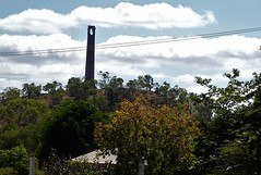 Chillagoe. One of the old smelter chimneys seen from the main part of the town. These smelters operated from 1906 to 1943 but an earlier smelter began in 1900. (denisbin) Tags: karst landscape chillagoe athertontablelands church catholic bank vault bankvault cathedral cathedralrock pews