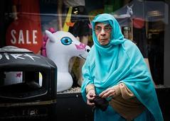 In Search of Unicorns (XBeauPhoto) Tags: bricklane july2017 london asian colours elderly elderlywoman pensive shawl shopwindow street streetphotography unicorn urbanstreet