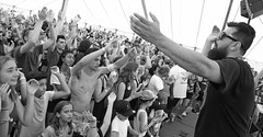 Workshop Welcome (peterkelly) Tags: bw guelph ontario canada guelphlakeconservationarea northamerica concert music hillside hillsidefestival 2017 festival musician player playing workshop boogat sunglasses tent crowd audience djshub cheering arm