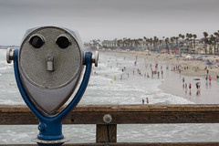 Here is Looking At You [Explored] (Photos By Clark) Tags: beachshots canon2470 canon60d sandiegogeneral subjects oceanside california unitedstates ocean pier pacific lightroom beach blue cloudy mist rail wood bathers swimmers palm condo water waves surf explored silver gray swim sand canonl