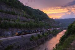 CSX Q696 in Pikeville, KY (Brandon Townley) Tags: trains railroad csx kentucky bigsandy sunset river water reflection co sky sun clouds