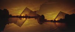 pyramides (m_travels) Tags: doubleexposure multiple paris louvre sunset pentaxkmasahi architecture analog technique redscale diy lomography400 reversesideofthefilm 35mmfilm argentique filmphotography experimental flippedfilm miltiexposure overlappingframes france