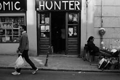 comic hunter (doistrakh) Tags: slr olympus om4ti zuikoautos40mmf2 filmcamera vintagecamera 135 film monochrome bw blackandwhite travel europe spain espana streetphotography madrid elrastromarket fleamarket