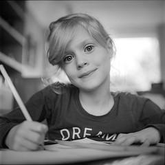 Homework (Erik de Klerck) Tags: girl child homework portrait portret blackandwhite black white blond rollei rollfilm rolleicord kodak kodaktrix trix hc110 rolleinar eyes manualfocus tlr twin twinlensreflex