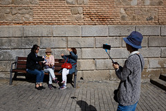 Toledo, Spain (jaumescar) Tags: toledo castillalamancha spain tourist chinese selfie smartphone hat color sunny light hot group old bench wall streetphotography tour visitor street photo