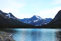 quiet lake (ekelly80) Tags: montana glaciernationalpark nationalparkservice nps manyglacier june2017 roadtrip keisgoesusa optoutside findyourpark mountains rockymountains view scenery lake water swiftcurrentlake sunset sky night evening light quiet snow snowy rocks